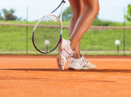 Legs of female tennis player.Close up image.